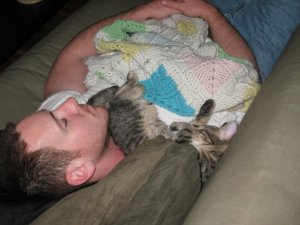 True love - Munkey and The Man napping together a couple of years ago. He's too big to sleep on someone's neck now, but this basic scene still plays out most days at our house.