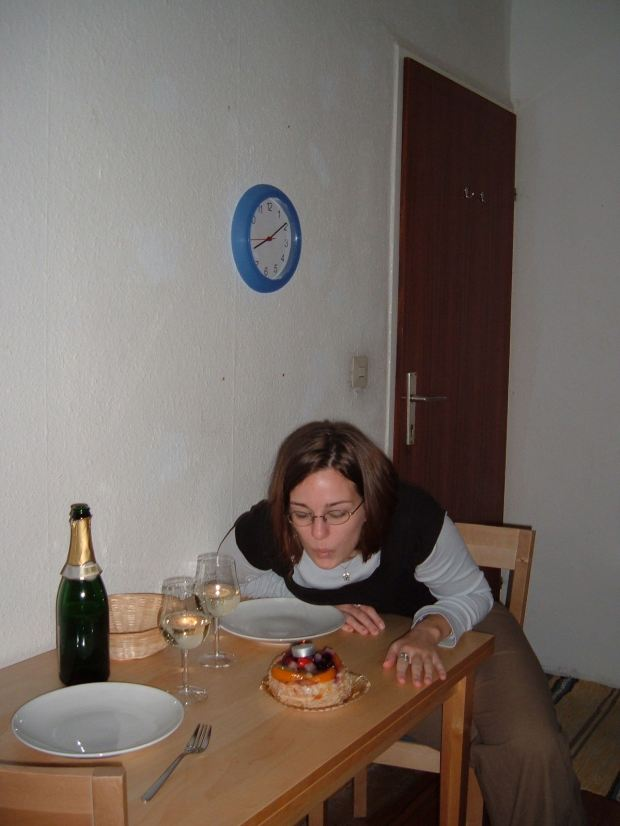 Blowing out my birthday candle in Vienna on my 23rd birthday, 2004. KT bought me this amazing birthday tart (and of course champagne - birthdays MUST have champagne).