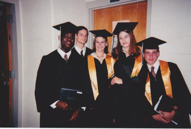 At graduation, making a silly face (as always). I'm the one with long hair, and Aydrian's directly to my left.